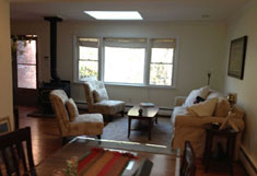 Huntington House Rental - Skylight in Living Room with Wood Burning Stove - RENTED