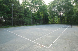 Lloyd Harbor Wooded Retreat with Country Club Setting - Lighted Har-Tru Tennis Court - SOLD